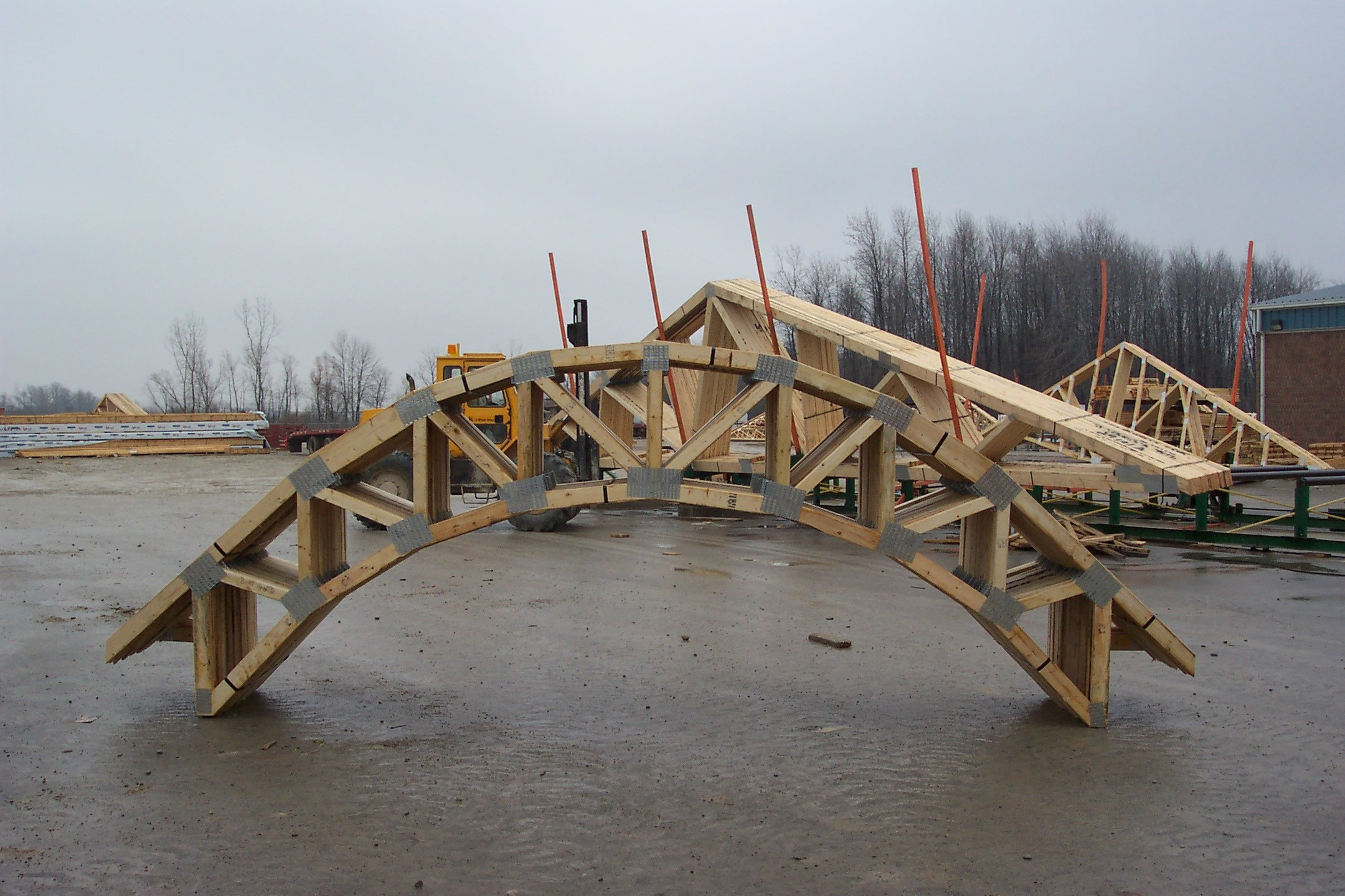 London roof truss inc london roof truss inc for Pre engineered trusses